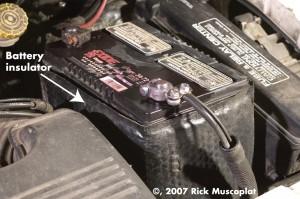Battery insulator, car battery, dead battery