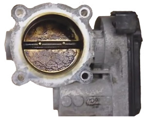 carbon buldup on throttle plate of electronic throttle body