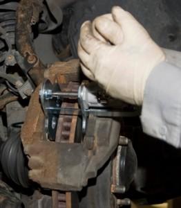 brake caliper piston retraction tool in use