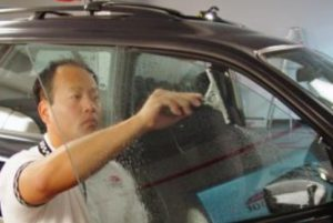 squeegee on car window tinting film