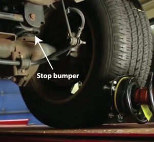Check stop bumper condition before repalcing the strut assembly