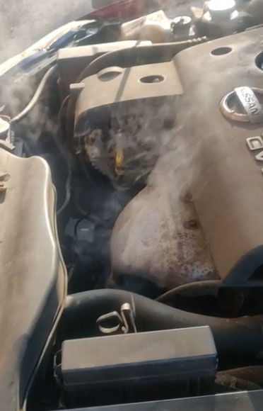 smoking from under the hood