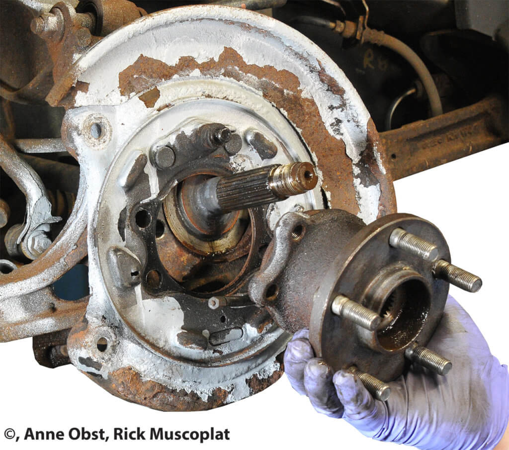 wheel bearing removed from axle shaft and knuckle